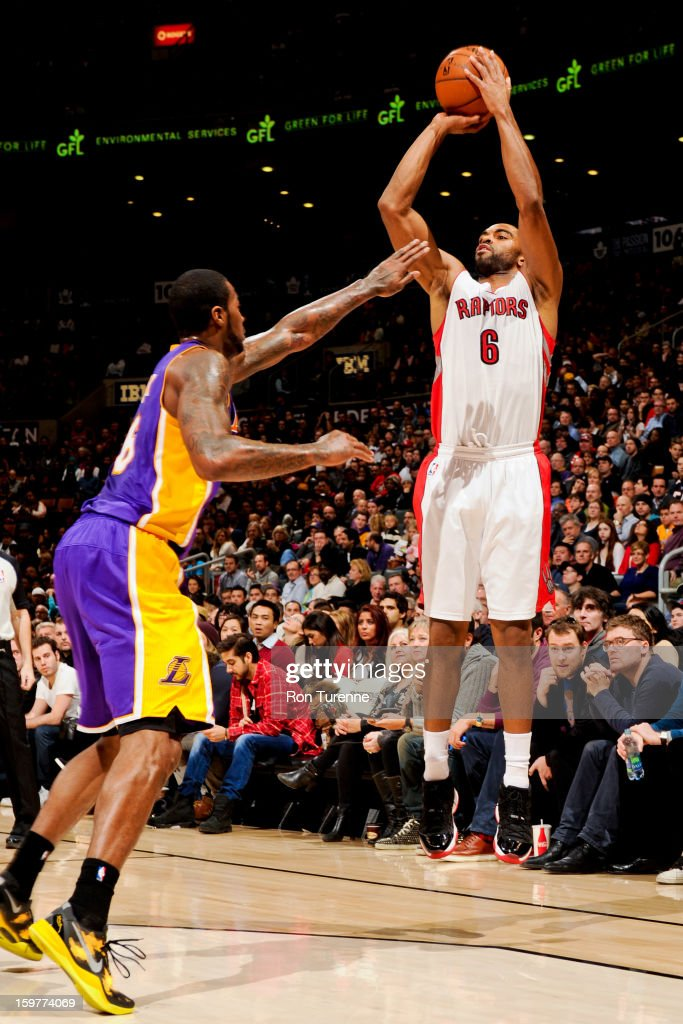 Alan Anderson #6 of the Toronto Raptors shoots a three-pointer against Earl Clark #6 of the Los Angeles Lakers on January 20, 2013 at the Air Canada Centre in Toronto, Ontario, Canada.