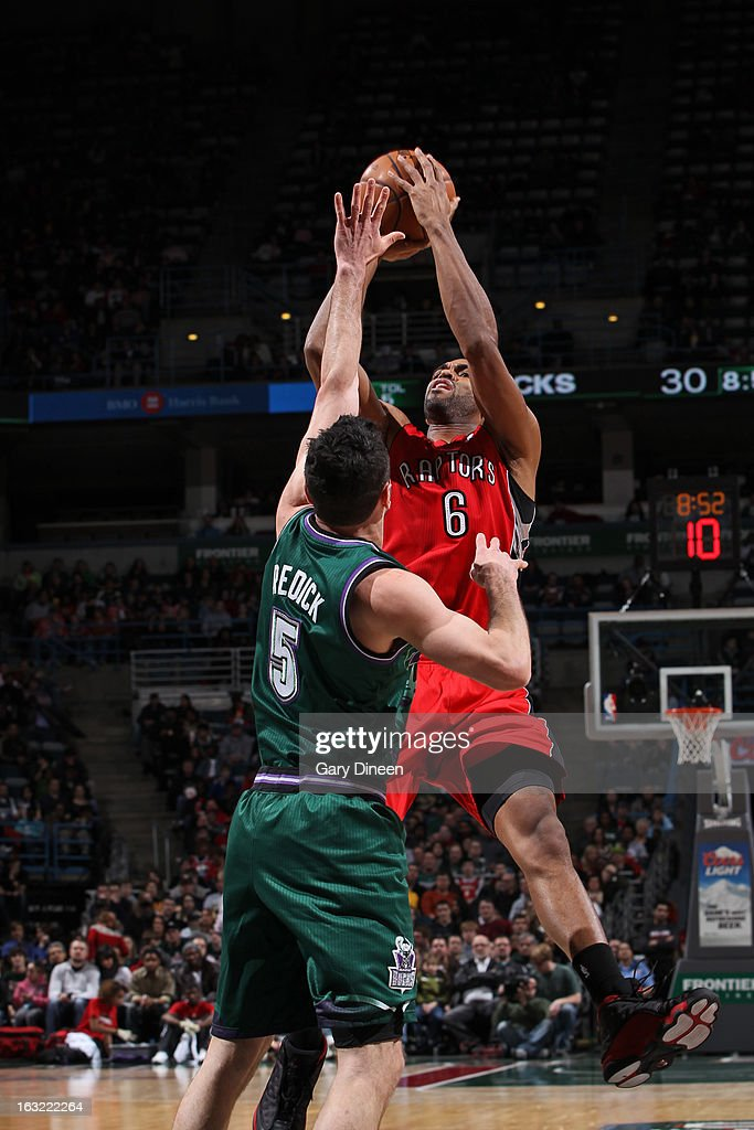 <a gi-track='captionPersonalityLinkClicked' href=/galleries/search?phrase=Alan+Anderson&family=editorial&specificpeople=3945355 ng-click='$event.stopPropagation()'>Alan Anderson</a> #6 of the Toronto Raptors takes a shot against the Milwaukee Bucks on March 2, 2013 at the BMO Harris Bradley Center in Milwaukee, Wisconsin.