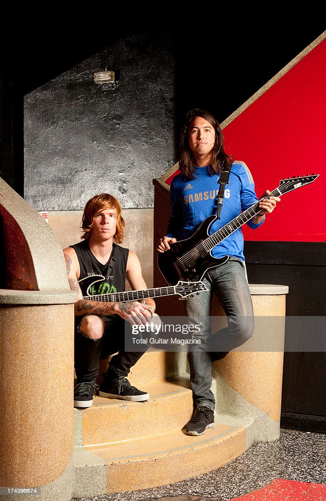 Alan Ashby (L) and Phil Manansala, guitarists of American metalcore band Of Mice & Men, photographed during a portrait shoot for Total Guitar Magazine, October 10, 2012.