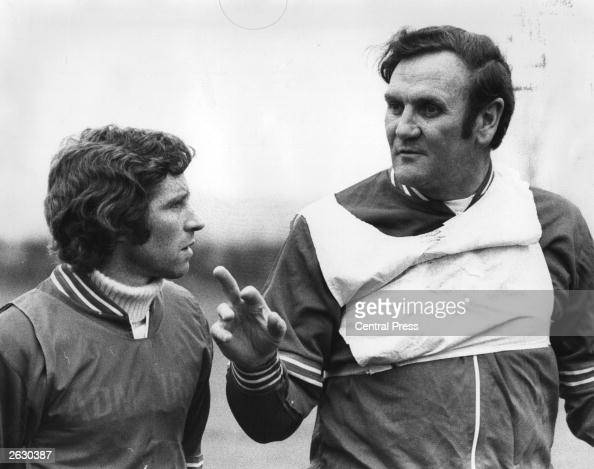 Alan Ball the Arsenal football player and England's Captain listening to England manager Don Revie who is advising him on the match against West...