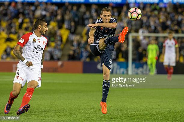 Alan Baro of Melbourne Victory clears the ball in front of Kerem Bulut of the Western Sydney Wanderers during the 6th round of the Hyundai ALeague...