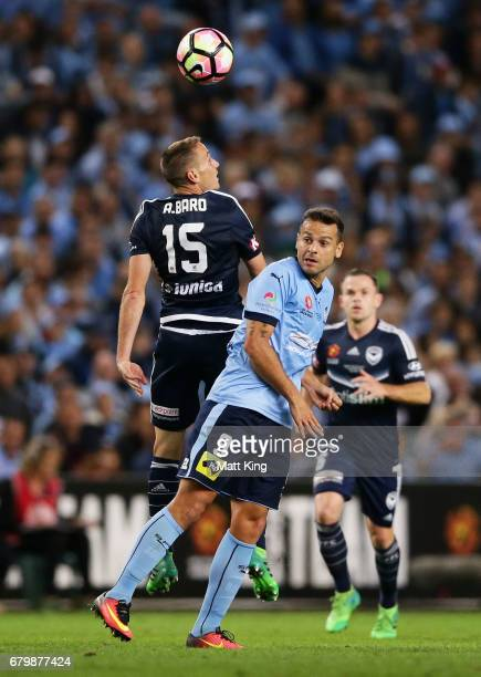 Alan Baro of Melbourne Victory competes for the ball against Bobo of Sydney FC during the 2017 ALeague Grand Final match between Sydney FC and the...