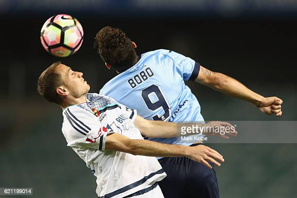 Alan Baro of the Victory and Bob of Sydney FC compete for the ball in the air during the round five ALeague match between Sydney FC and the Melbourne...