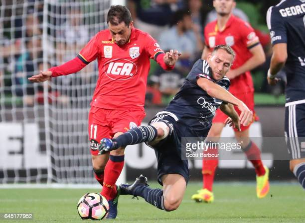 Alan Baro of the Victory and Sergio Cirio of United compete for the ball during the round 21 ALeague match between Melbourne Victory and Adelaide...