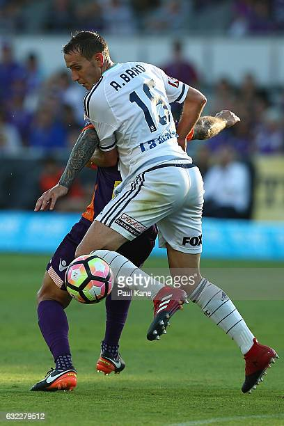 Alan Baro of the Victory challenges Adam Taggart of the Glory during the round 16 ALeague match between Perth Glory and Melbourne Victory at nib...