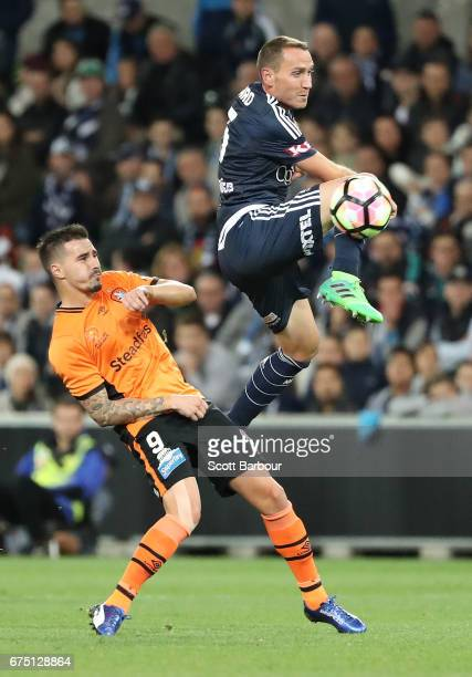 Alan Baro of the Victory competes for the ball during the ALeague Semi Final match between Melbourne Victory and the Brisbane Roar at AAMI Park on...