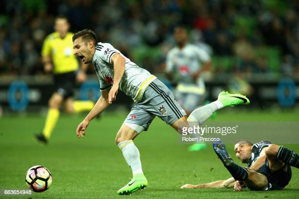 Alan Baro of the Victory receives a red card after applying this tackle on Kosta Barbarouses of the Phoenix during the round 25 ALeague match between...