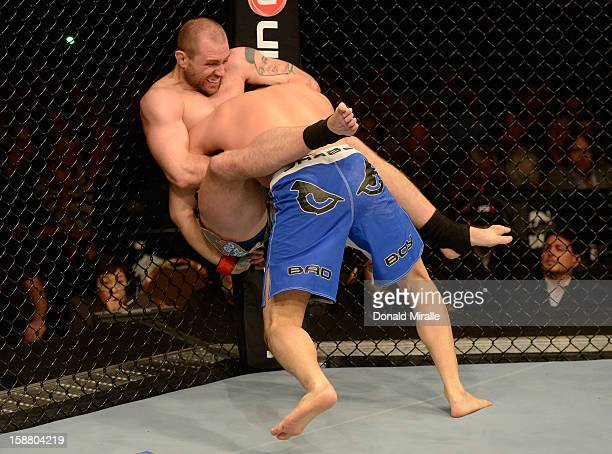 Alan Belcher attempts to submit Yushin Okami during their middleweight fight at UFC 155 on December 29 2012 at MGM Grand Garden Arena in Las Vegas...