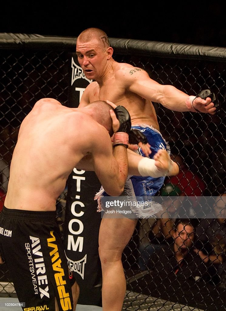 Alan Belcher (blue/white shorts) def. Kalib Starnes (black shorts) - TKO - 2:47 round 2 during the UFC 77 at US Bank Arena on October 20, 2007 in Cincinnati, Ohio.