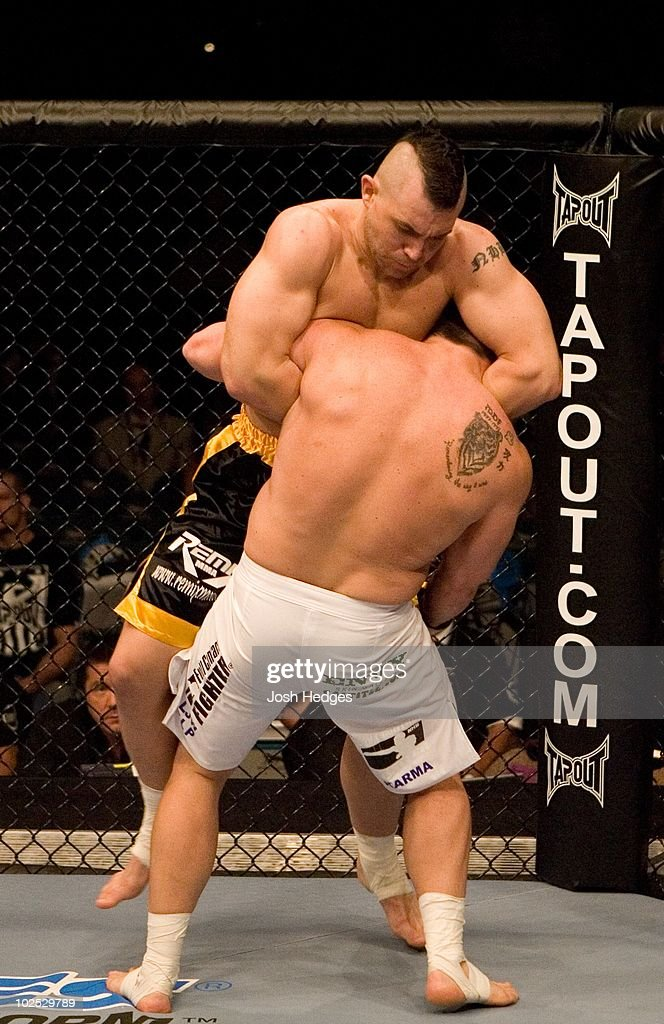Alan Belcher (black/yellow shorts) def. Sean Salmon (white shorts) - Submission (guillotine choke) - :53 round 1 during UFC 71 at MGM Grand Garden Arena on May 26, 2007 in Las Vegas, Nevada.