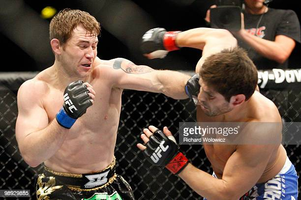 Alan Belcher punches Patrick Cote in their middleweight bout at UFC 113 at Bell Centre on May 8 2010 in Montreal Quebec Canada