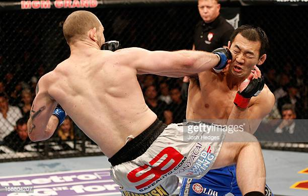 Alan Belcher punches Yushin Okami during their middleweight fight at UFC 155 on December 29 2012 at MGM Grand Garden Arena in Las Vegas Nevada