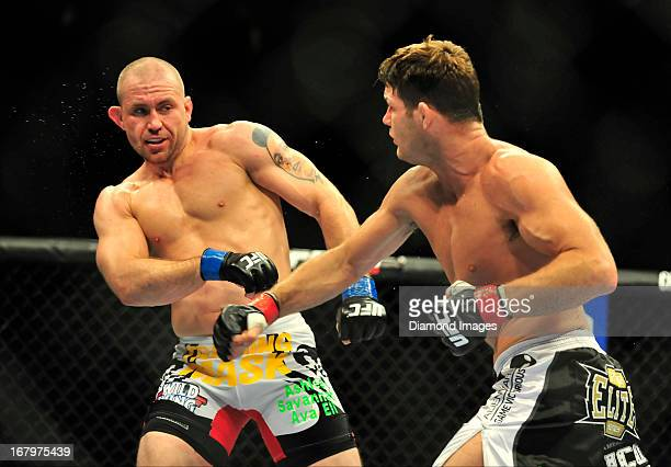 Alan Belcher reacts after being punched by Michael Bisping during UFC 159 Jones v Sonnen at Prudential Center in Newark New Jersey