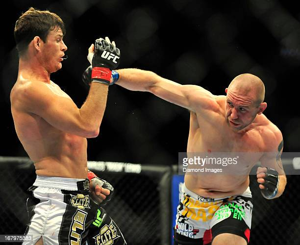 Alan Belcher throws a punch at Michael Bisping during a middleweight bout during UFC 159 Jones v Sonnen at Prudential Center in Newark New Jersey