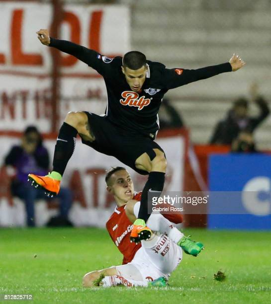 Alan Benitez of Libertad fights for the ball with Norberto Briasco of Huracan during a first leg match between Huracan and Libertad as part of second...