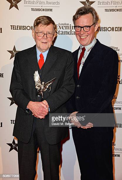 Alan Bennett winner of the Special Award and presenter Alex Jennings pose in front of the Winners Boards at the London Evening Standard British Film...