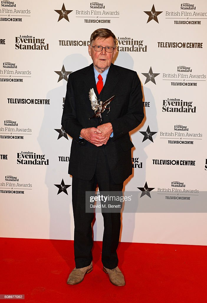 Alan Bennett winner of the Special Award poses in front of the Winners Boards at the London Evening Standard British Film Awards at Television Centre...
