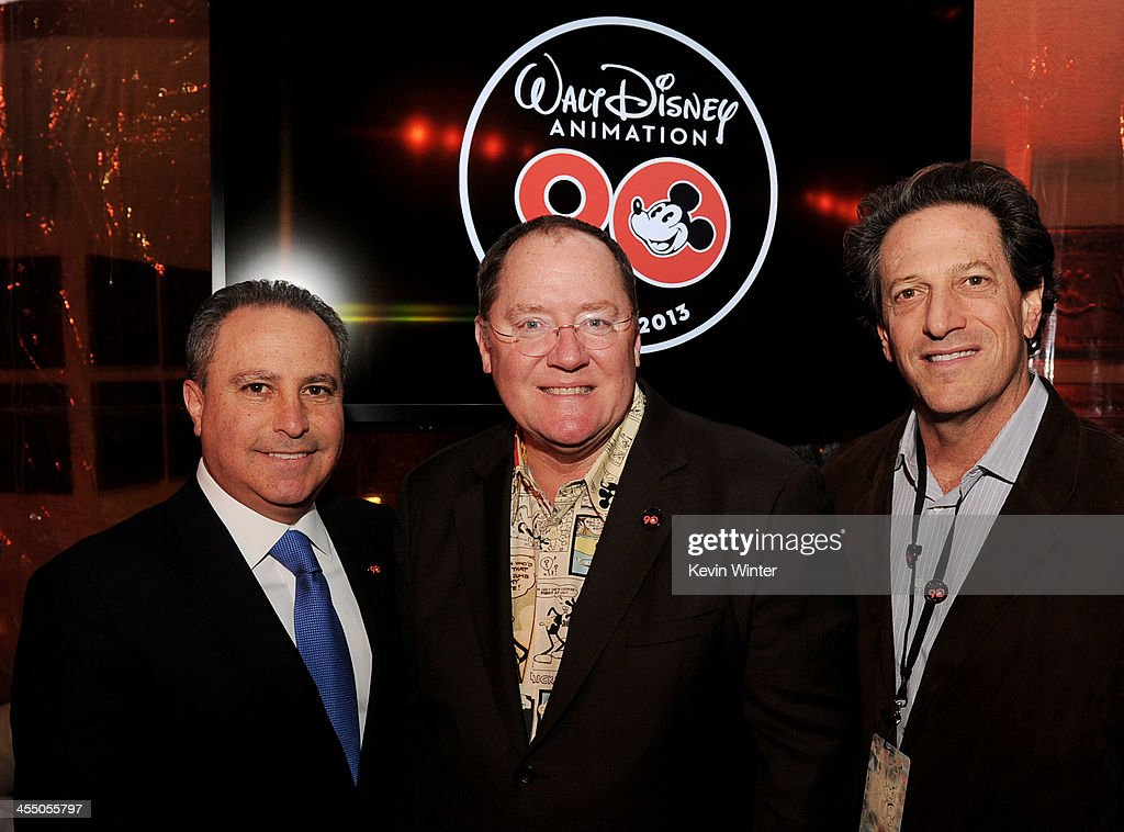 Alan Bergman, President, Walt Disney Studios, <a gi-track='captionPersonalityLinkClicked' href=/galleries/search?phrase=John+Lasseter&family=editorial&specificpeople=224003 ng-click='$event.stopPropagation()'>John Lasseter</a>, Chief Creative Officer, Pixar and Walt Disney Animation Studios and Andrew Millstein, General Manager, Walt Disney Animation Studios pose at a reception to celebrate 90 Years of Disney animation at The Walt Disney Studios on December 10, 2013 in Burbank, California.