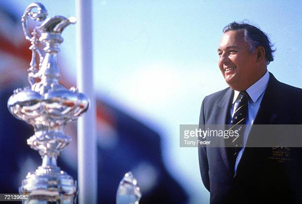 Alan Bond stands during the presentation after the America's Cup in Fremantle 1993 in Perth Australia Stars and Stripes of the USA beat Australia...