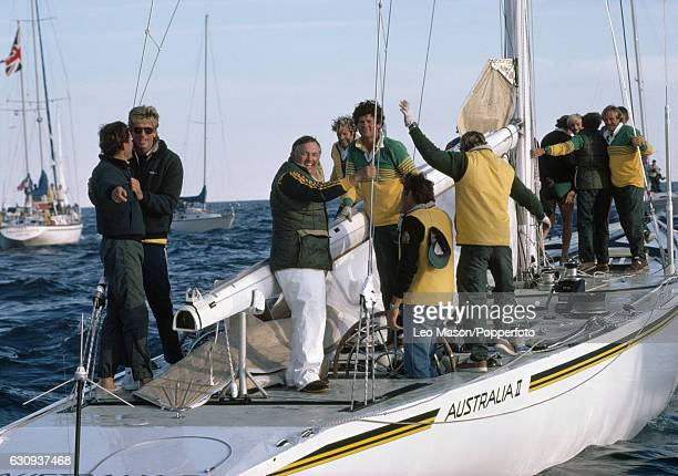 Alan Bond the Australian businessman and leader of the syndicate which owned the victorious Australia II celebrates on board after winning the...