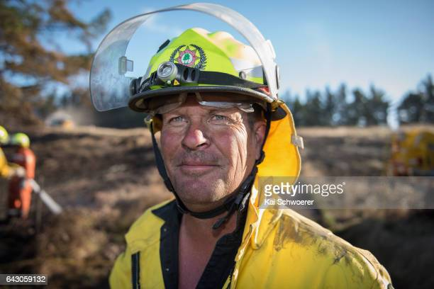 Alan Butterick of the Lauriston Rural Fire Force looks on on February 20 2017 in Christchurch New Zealand Firefighters continue to work to contain...