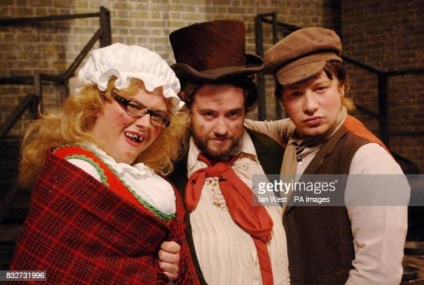 Alan Carr Justin Lee Collins and Jamie Oliver as Oliver Twist film a sketch for the Friday Night Project at the London Studios in central London