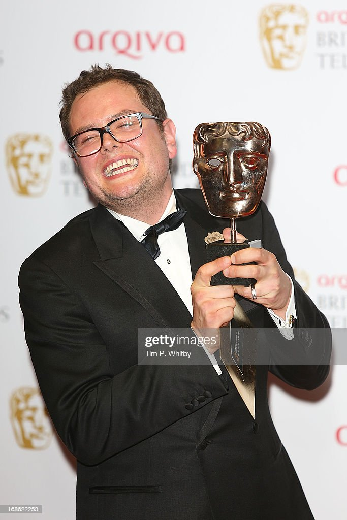 <a gi-track='captionPersonalityLinkClicked' href=/galleries/search?phrase=Alan+Carr&family=editorial&specificpeople=559469 ng-click='$event.stopPropagation()'>Alan Carr</a> poses with his award for Best Entertainment Performance the Arqiva British Academy Television Awards 2013 at the Royal Festival Hall on May 12, 2013 in London, England.
