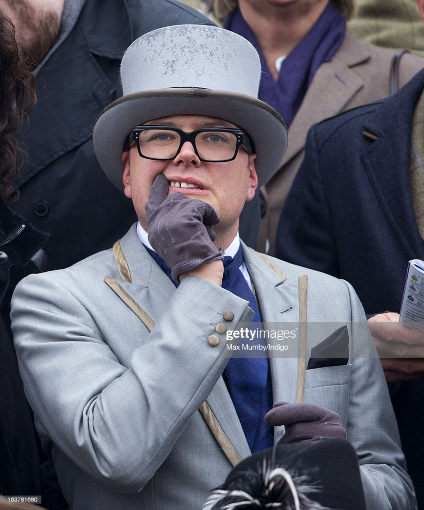 Alan Carr watches the racing as he attends Day 4 of The Cheltenham Festival at Cheltenham Racecourse on March 15, 2013 in London, England.