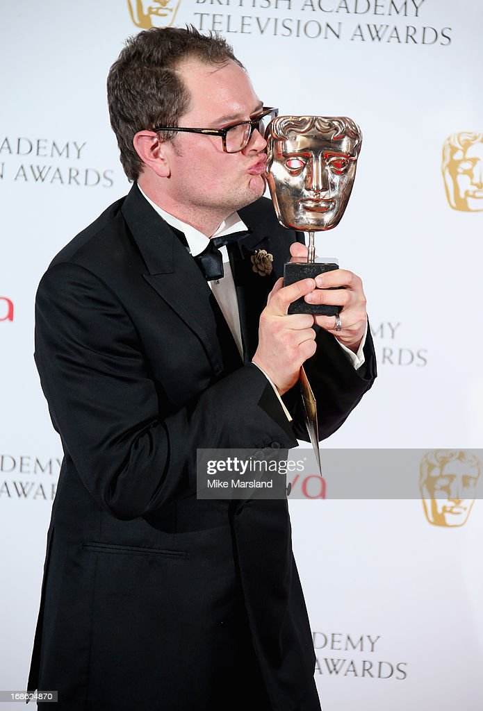 Alan Carr with his Best Entertainment Performance award during the Arqiva British Academy Television Awards 2013 at the Royal Festival Hall on May 12, 2013 in London, England.