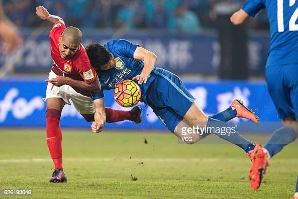 Alan Carvalho of Guangzhou Evergrande and Ji Xiang of Jiangsu Suning vie for the ball during the final second leg of Yanjing Beer 2016 Chinese...