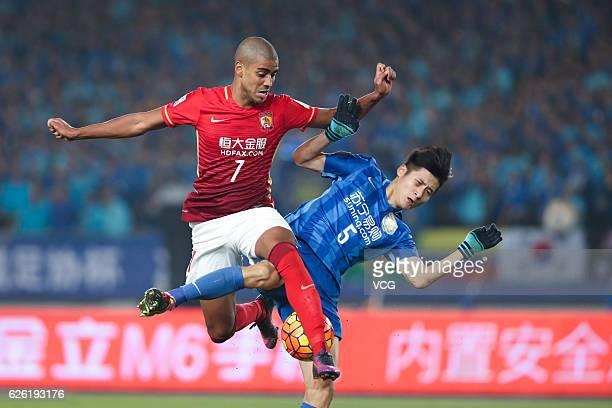 Alan Carvalho of Guangzhou Evergrande and Zhou Yun of Jiangsu Suning vie for the ball during the final second leg of Yanjing Beer 2016 Chinese...