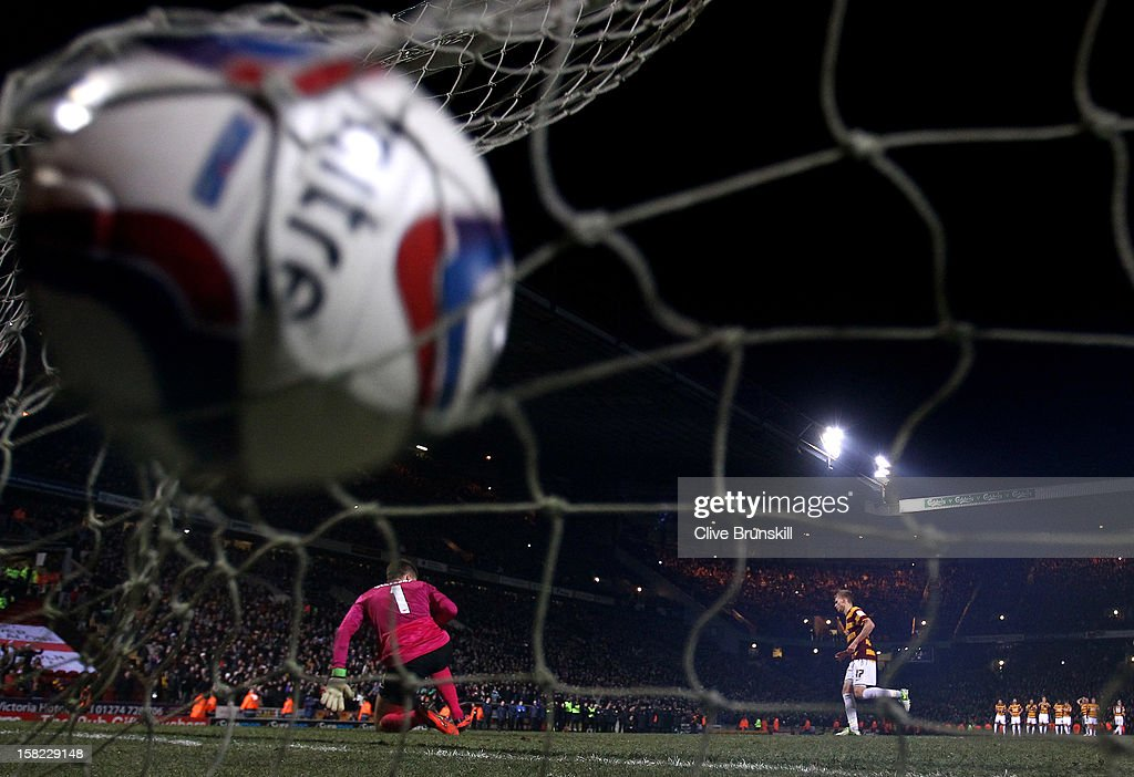 Alan Connell of Bradford scores with his penalty attempt past goalkeeper Wojciech Szczesny of Arsenal during the Capital One Cup quarter final match between Bradford City and Arsenal at the Coral Windows Stadium, Valley Parade on December 11, 2012 in Bradford, England.