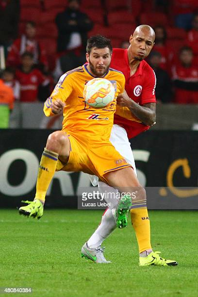 Alan Costa of Internacional battles for the ball against Andre Pierre Gignac of Tigres during the match between Internacional v Tigres as part of...