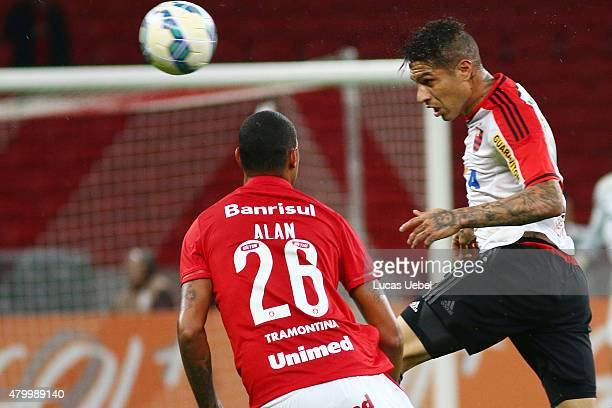 Alan Costa of Internacional battles for the ball against Paolo Guerrero of Flamengo during the match between Internacional and Flamengo as part of...