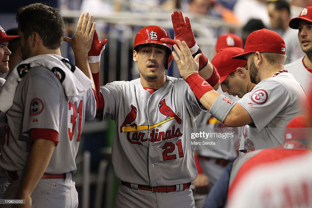 Alan Craig #21 of the St. Louis Cardinals celebrates with teamates against the Miami Marlins during the first inning at Marlins Park on June 15, 2013 in Miami, Florida.