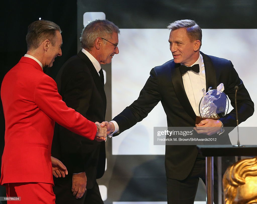 Alan Cumming and Harrison Ford present the Britannia Award for British Artist of the Year to Honoree Daniel Craig onstage at the 2012 BAFTA Los Angeles Britannia Awards Presented By BBC AMERICA at The Beverly Hilton Hotel on November 7, 2012 in Beverly Hills, California.