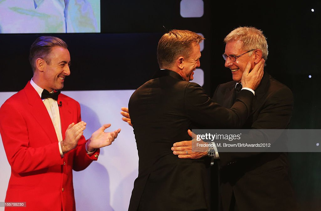 Alan Cumming (L) and Harrison Ford (R) present the Britannia Award for British Artist of the Year to Honoree Daniel Craig (Middle) onstage at the 2012 BAFTA Los Angeles Britannia Awards Presented By BBC AMERICA at The Beverly Hilton Hotel on November 7, 2012 in Beverly Hills, California.