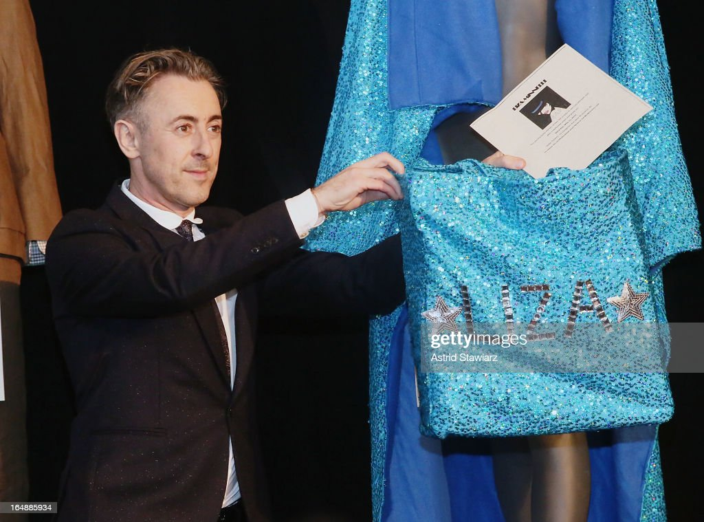 Alan Cumming holds a bag belonging to Liza Minnelli at the Bailey House 30th Anniversary Auction & Gala at Pier Sixty at Chelsea Piers on March 28, 2013 in New York City.