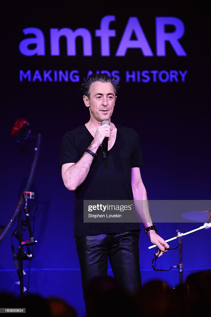 Alan Cumming performs onstage at the amfAR New York Gala to kick off Fall 2013 Fashion Week at Cipriani Wall Street on February 6, 2013 in New York City.