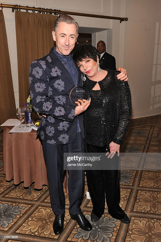 Alan Cumming recipient of the Award of Courage (L) and Liza Minelli pose backstage during the 4th Annual amfAR Inspiration Gala New York at The Plaza Hotel on June 13, 2013 in New York City.
