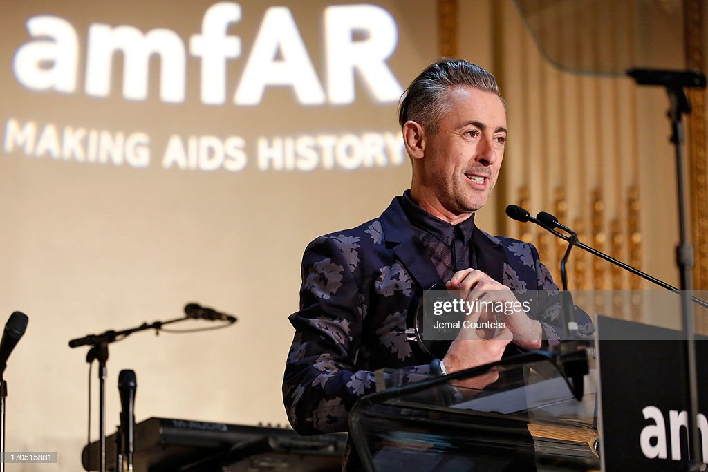 Alan Cumming recipient of the Award of Courage speaks on stage during the 4th Annual amfAR Inspiration Gala New York at The Plaza Hotel on June 13, 2013 in New York City.