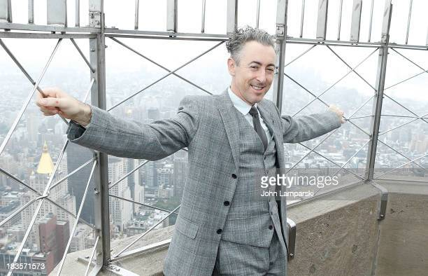 Alan Cumming visits the Empire State Building in celebration of Broadway's 'Only Make Believe' at The Empire State Building on October 7 2013 in New...