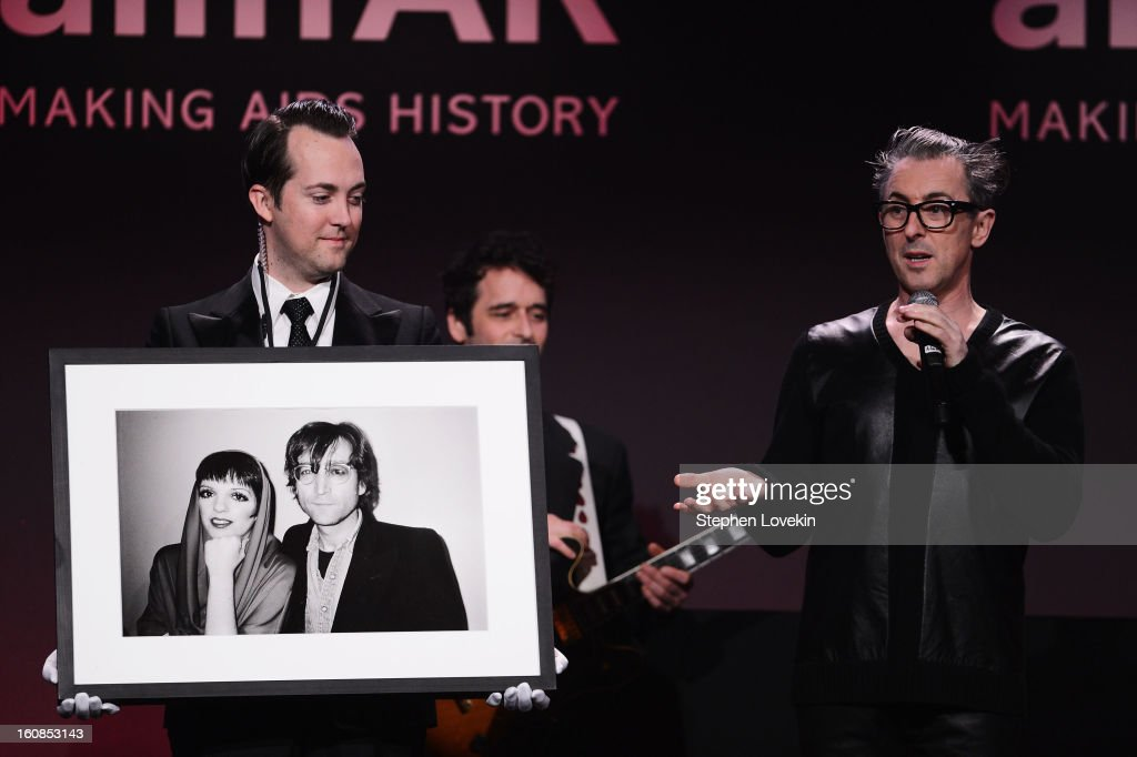 <a gi-track='captionPersonalityLinkClicked' href=/galleries/search?phrase=Alan+Cumming&family=editorial&specificpeople=202521 ng-click='$event.stopPropagation()'>Alan Cumming</a>s (R) speaks onstage at the amfAR New York Gala to kick off Fall 2013 Fashion Week at Cipriani Wall Street on February 6, 2013 in New York City.