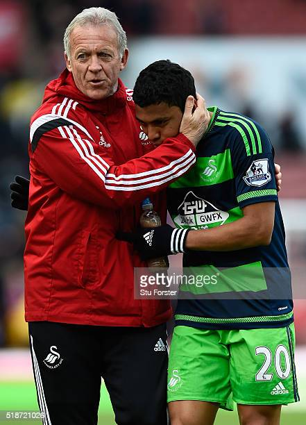 Alan Curtis assistant manager of Swansea City congratulates Jefferson Montero during the Barclays Premier League match between Stoke City and Swansea...