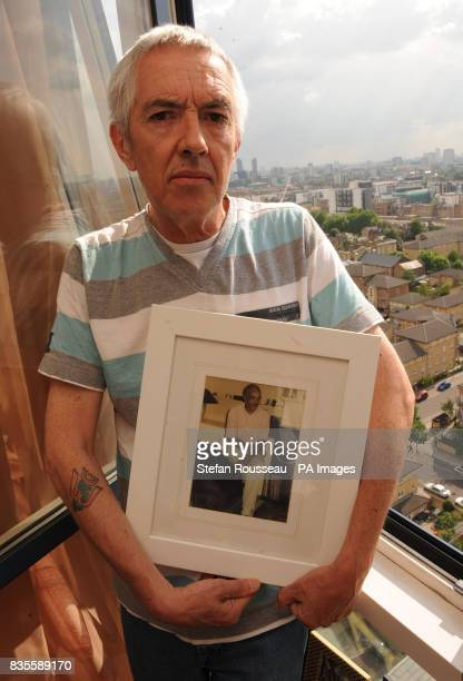 Alan Cutkelvin Rees from Hackney north London with a photograph of his partner Raymond Cutkelvin whom he accompanied to Zurich two years ago in order...