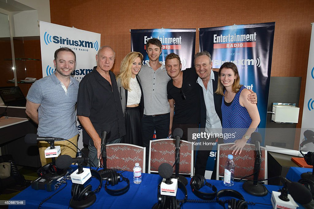 Alan Dale, Roxanne McKee, Chris Egan, Tom Wisdom and Anthony Stewart Head pose with radio hosts Mario Correa and Julia Cunningham after being interviewed on SiriusXM's Entertainment Weekly Radio channel from Comic-Con 2014 at The Hard Rock Hotel on July 25, 2014 in San Diego, California.