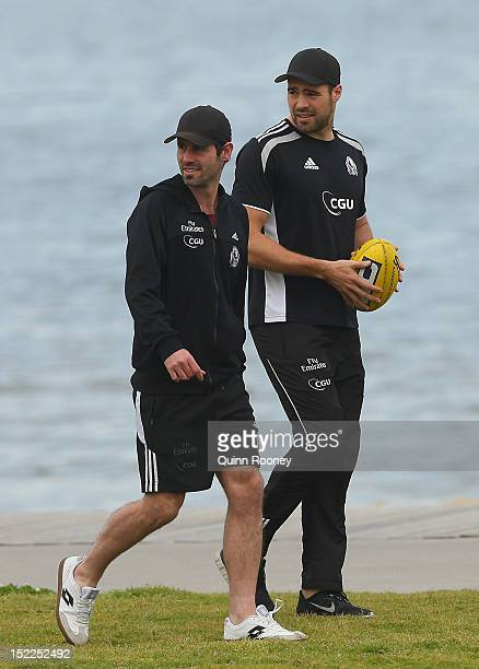 Alan Didak and Chris Dawes of the Magpies walk along the beach during a Collingwod Magpies AFL recovery sessionat the St Kilda Sea Baths on September...