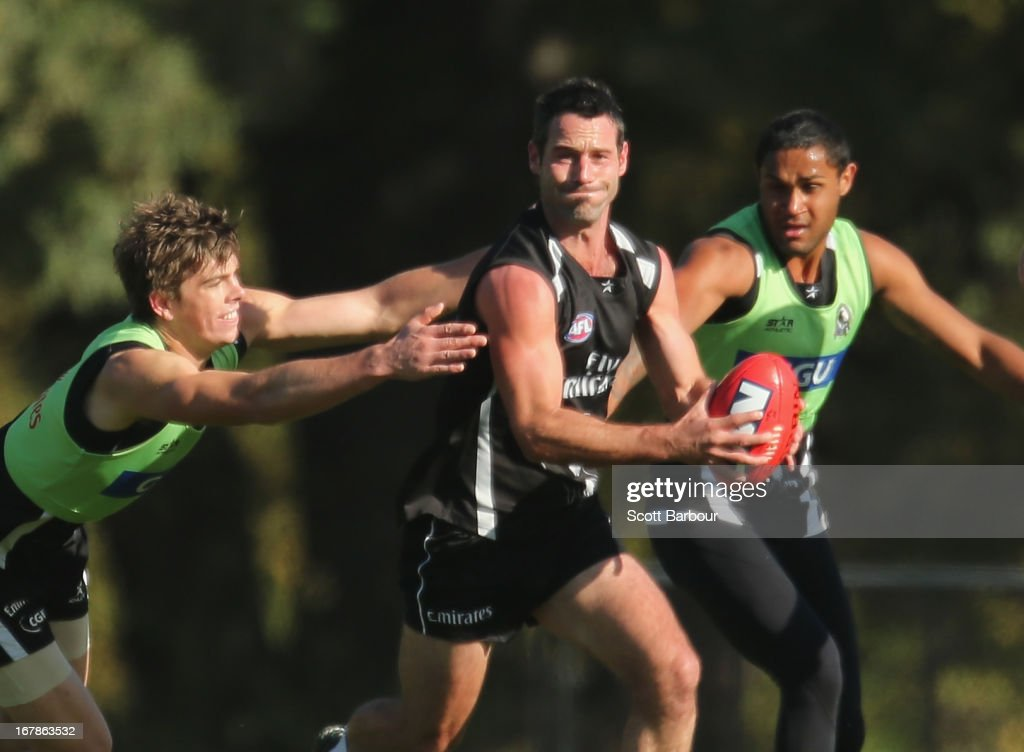 <a gi-track='captionPersonalityLinkClicked' href=/galleries/search?phrase=Alan+Didak&family=editorial&specificpeople=217271 ng-click='$event.stopPropagation()'>Alan Didak</a> of the Magpies runs with the ball during a Collingwood Magpies AFL training session at Olympic Park on May 2, 2013 in Melbourne, Australia.