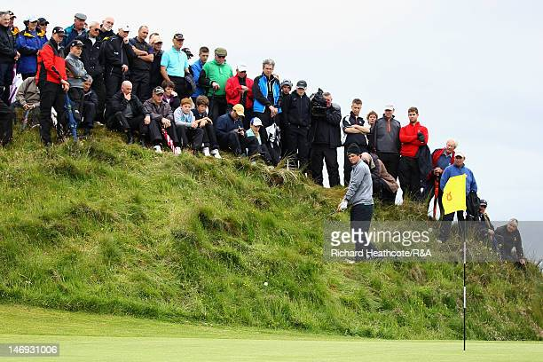 Alan Dunbar plays from deep rough above the 8th green during the Final of the 2012 Amateur Championships between Alan Dunbar of Rathbone Northern...