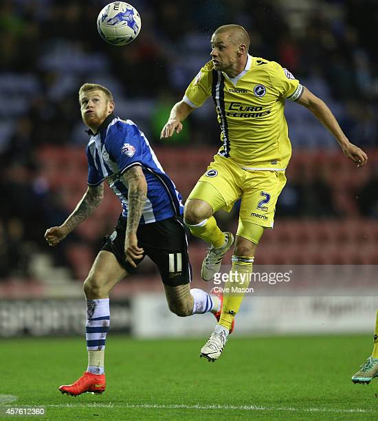 Alan Dunne of Millwall beats James McClean of Wigan to the ball during the Sky Bet Championship match between Wigan Athletic and Millwall at DW...